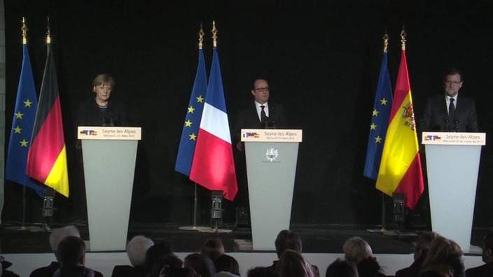 Chancellor Merkel, President Hollande and Spanish Prime Minister Mariano Rajoy at the news conference on Wednesday afternoon.