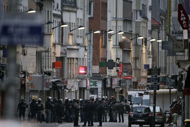 Policemen are gathered in the northern Paris suburb of Saint-Denis city centre