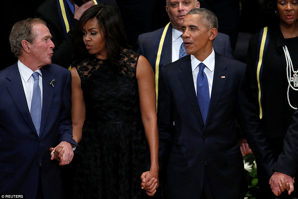 Song: Former president George W. Bush, First Lady Michelle Obama and U.S. President Barack Obama sing the Battle Hymn of the Republic at the end of the memorial service for the murdered police officers who died in Dallas last week