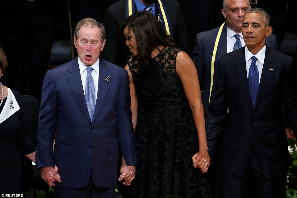 Involved: Former president George W. Bush sings enthusiastically along to the Battle Hymn of the Republic with First Lady Michelle Obama