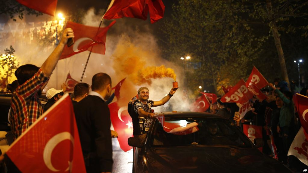 """Supporters of the """"Yes"""" vote, celebrate in Istanbul, on Sunday, April 16, 2017."""