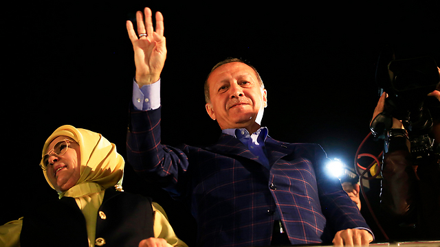 President Erdoğan and wife Emine wave to the crowd following referendum victory (Photo: AP)