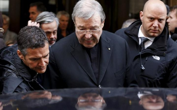 Australian Cardinal George Pell leaves at the end of a meeting with the victims of (-) abuse, at the Quirinale hotel in Rome