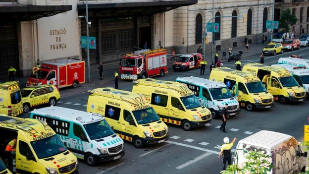 Emergency vehicles are parked in front of Francia station in central Barcelona on 28 July 2017 after a regional train hit the buffers inside the station